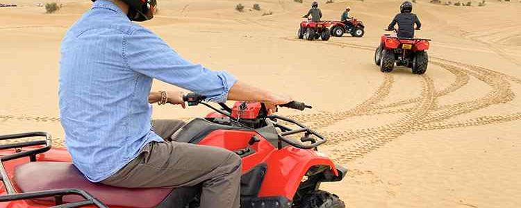 quad biking safari and dinner in the desert safari camp